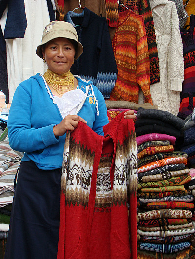 Otavaleña woman showing the alpaca wool sweater that I bought