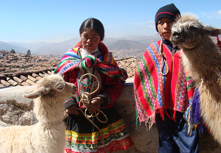 Children dress up in quasi traditional ponchos for tourists