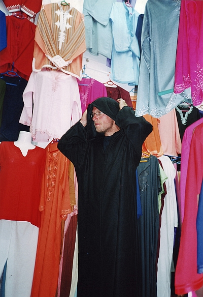 Marco shows a natural sense of wearing the right clothes at the right time. Souk in Marrakech