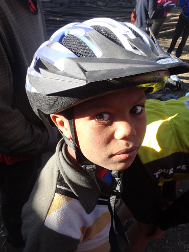 Boy with my bicycle helmet