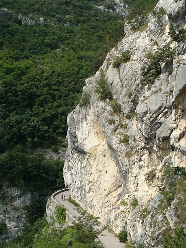 Spectacular descent through sheer cliffs walls to Lake Garda