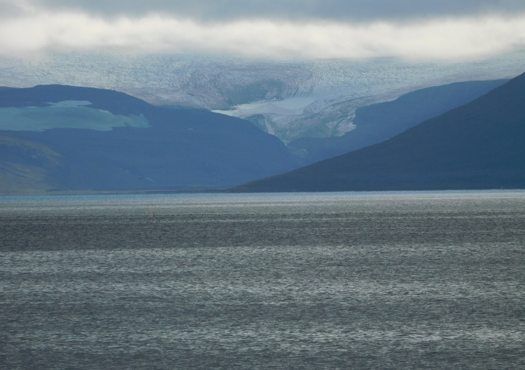 View over the fjord with the Kaldalón glacier and the Drangajökull ice cap in the background
