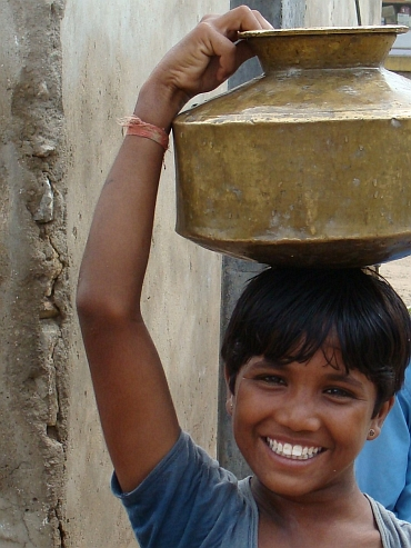 Boy with water bowl
