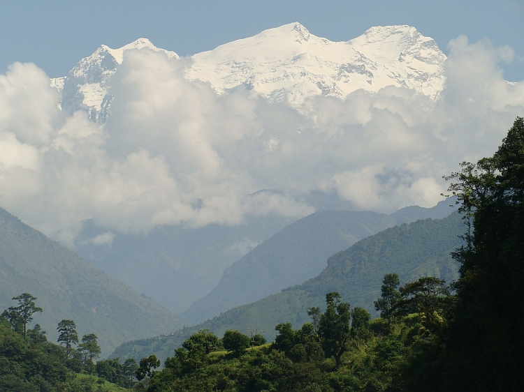 The Himal Chuli, 7.893 m high, towering above the rain forest